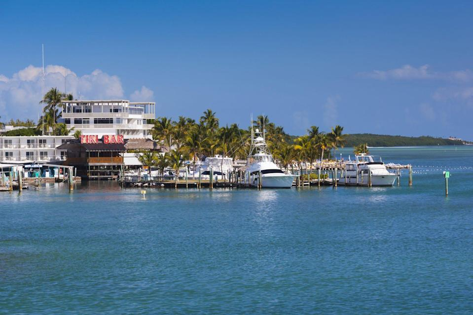"""<p>Located at the halfway point in the Florida Keys, <a href=""""http://www.fla-keys.com/islamorada/"""" rel=""""nofollow noopener"""" target=""""_blank"""" data-ylk=""""slk:Islamorada"""" class=""""link rapid-noclick-resp"""">Islamorada</a> is a whimsical paradise where small-town businesses cater to the ultimate island state of mind. If you're a beer lover, <a href=""""http://www.floridakeysbrewingco.com/"""" rel=""""nofollow noopener"""" target=""""_blank"""" data-ylk=""""slk:Florida Keys Brewing Co."""" class=""""link rapid-noclick-resp"""">Florida Keys Brewing Co.</a> and <a href=""""http://www.islamoradabeerco.com/"""" rel=""""nofollow noopener"""" target=""""_blank"""" data-ylk=""""slk:Islamorada Beer Company"""" class=""""link rapid-noclick-resp"""">Islamorada Beer Company</a> both serve up an impressive selection of local craft brews. Fine Florida-kitschy institutions like <a href=""""http://www.lazydaysislamorada.com/"""" rel=""""nofollow noopener"""" target=""""_blank"""" data-ylk=""""slk:Lazy Days Restaurant"""" class=""""link rapid-noclick-resp"""">Lazy Days Restaurant</a> and <a href=""""http://loreleicabanabar.com/"""" rel=""""nofollow noopener"""" target=""""_blank"""" data-ylk=""""slk:Lorelei Restaurant & Cabana Bar"""" class=""""link rapid-noclick-resp"""">Lorelei Restaurant & Cabana Bar</a> offer a quadruple threat of killer water views, fruity cocktails, live music, and fish tacos.</p>"""