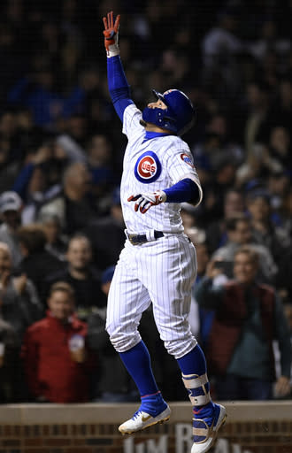 Chicago Cubs' Javier Baez celebrates at home plate after hitting a three-run home run during the sixth inning of a baseball game against the Los Angeles Dodgers, Wednesday, April 24, 2019, in Chicago. (AP Photo/Paul Beaty)