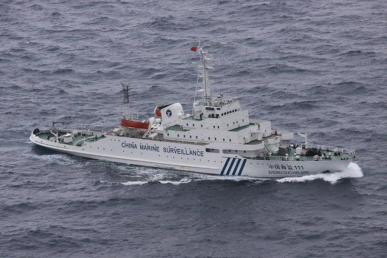 A Chinese marine surveillance ship cruises near disputed islands in the East China Sea on December 17, 2012