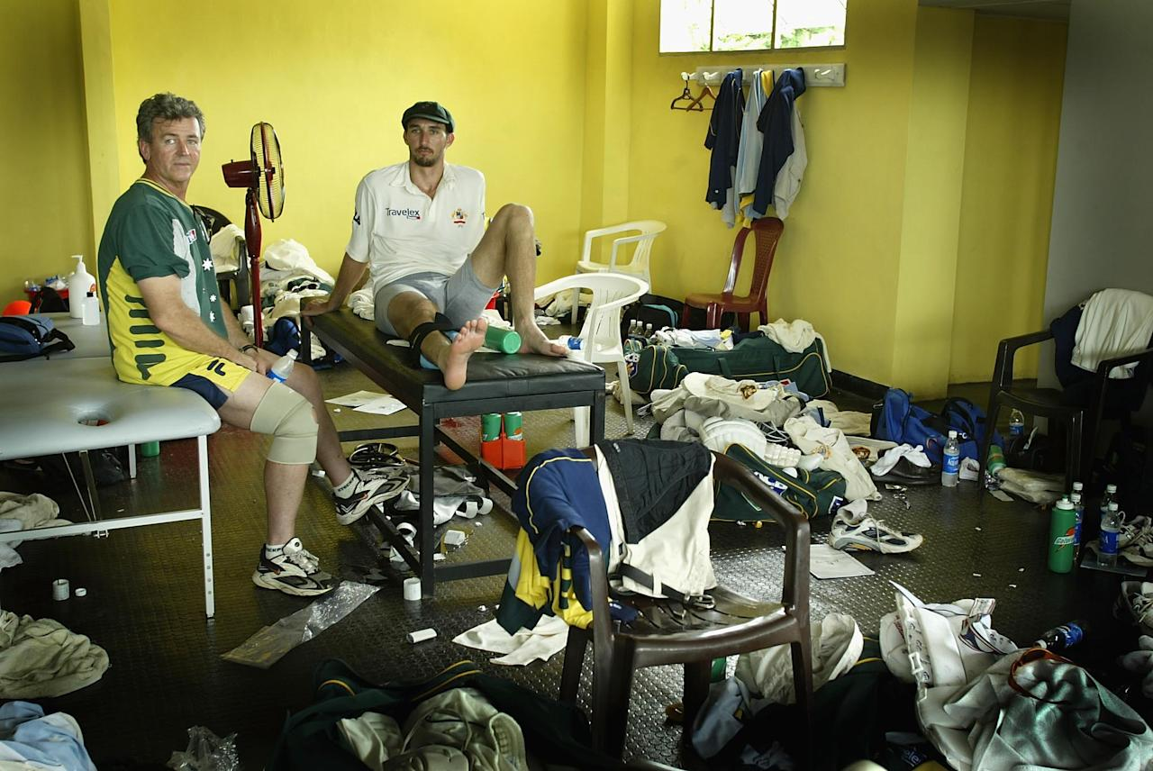 COLOMBO - OCTOBER 7:  Jason Gillespie of Australia and physio Erroll Alcott in the dressing room as Australia defeat Pakistan on the fifth day of the first test match between Pakistan and Australia at the P.Saravanamuttu Stadium in Colombo, Sri Lanka  on October 7, 2002. (Photo by Clive Mason/Getty Images.)