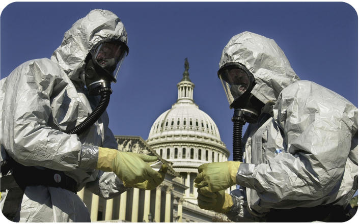 Members of the U.S. Marine Corps demonstrate anthrax cleanup techniques.