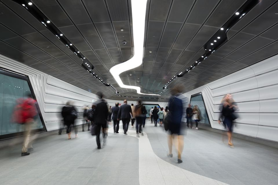 Blurred out, these images show office workers on their way to or from their jobs.