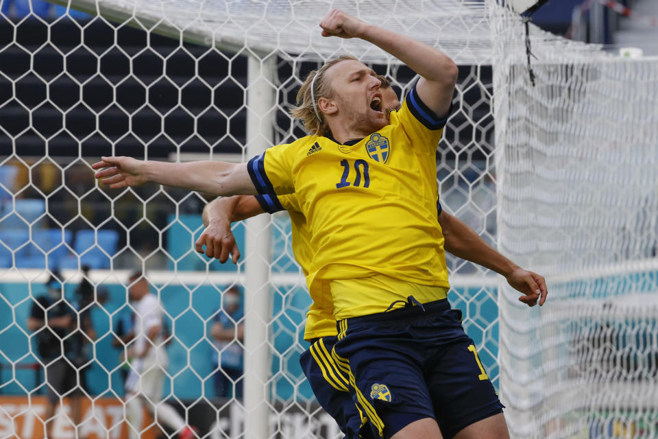 Sweden's Emil Forsberg celebrates after scoring his side's opening goal during the Euro 2020 soccer championship group E match between Sweden and Slovakia, at the Saint Petersburg stadium, in Saint Petersburg, Russia, Friday, June 18, 2021. (Anatoly Maltsev, Pool via AP)