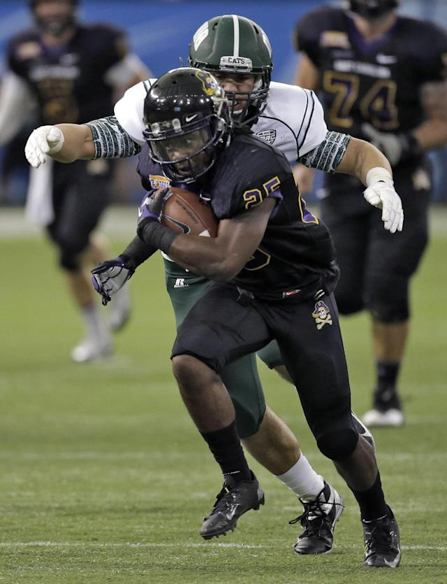 East Carolina running back Breon Allen (25) escapes the grasp of Ohio defensive end Kurt Laseak (99) during the first quarter of the Beef 'O' Brady's Bowl NCAA college football game Monday, Dec. 23, 2013, in St. Petersburg, Fla. (AP Photo/Chris O'Meara)