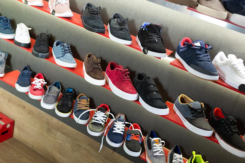 Style male sneakers on shelves in apparel boutique