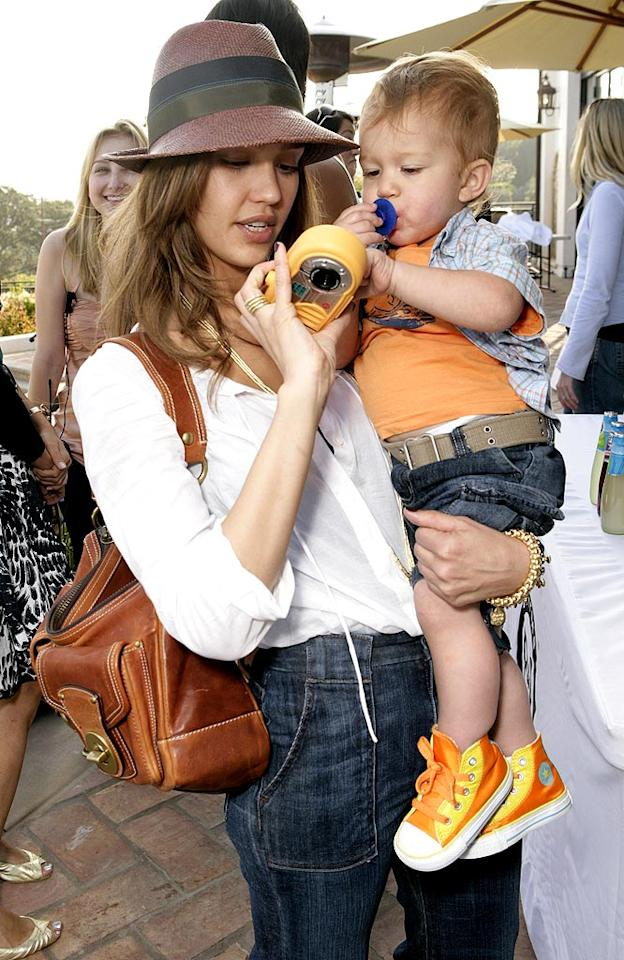 "Jessica Alba holding her nephew. Todd Williamson/<a href=""http://www.wireimage.com"" target=""new"">WireImage.com</a> - May 31, 2007"