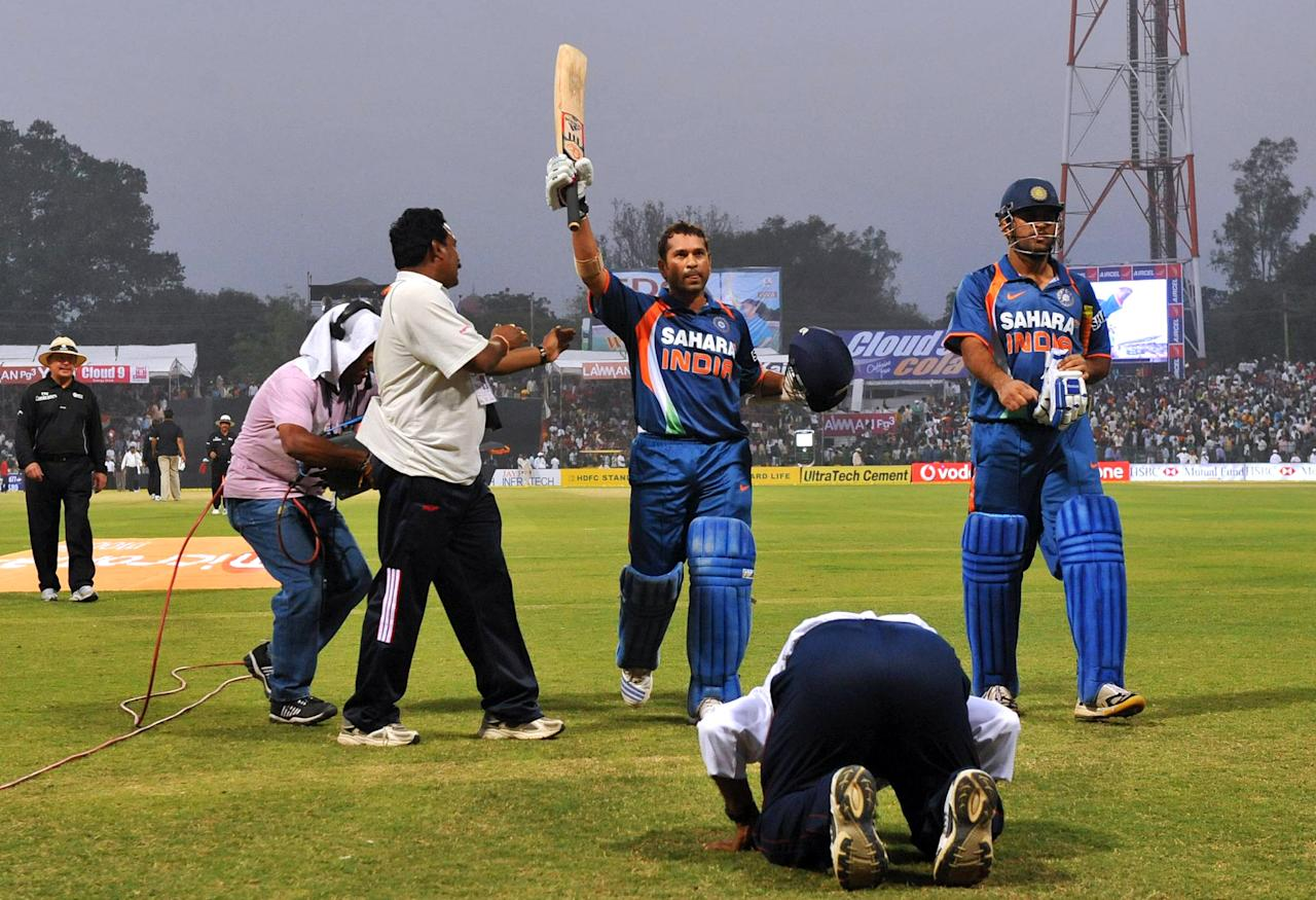 GWALIOR, INDIA - FEBRUARY 24: Sachin Tendulkar of India walks off the field and acknowledges the crowd as the first player in history to reach a double century in a one day international during the 2nd ODI between India and South Africa at Captain Roop Singh Stadium on February 24, 2010 in Gwalior, India. (Photo by Duif du Toit/Gallo Images/Getty Images)