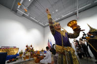 Thai dancers perform during a ceremony to return two stolen hand-carved sandstone lintels dating back to the 9th and 10th centuries to the Thai government Tuesday, May 25, 2021, in Los Angeles. The 1,500-pound (680-kilogram) antiquities had been stolen and exported from Thailand — a violation of Thai law — a half-century ago, authorities said, and donated to the city of San Francisco. They had been exhibited at the San Francisco Asian Art Museum. (AP Photo/Ashley Landis)