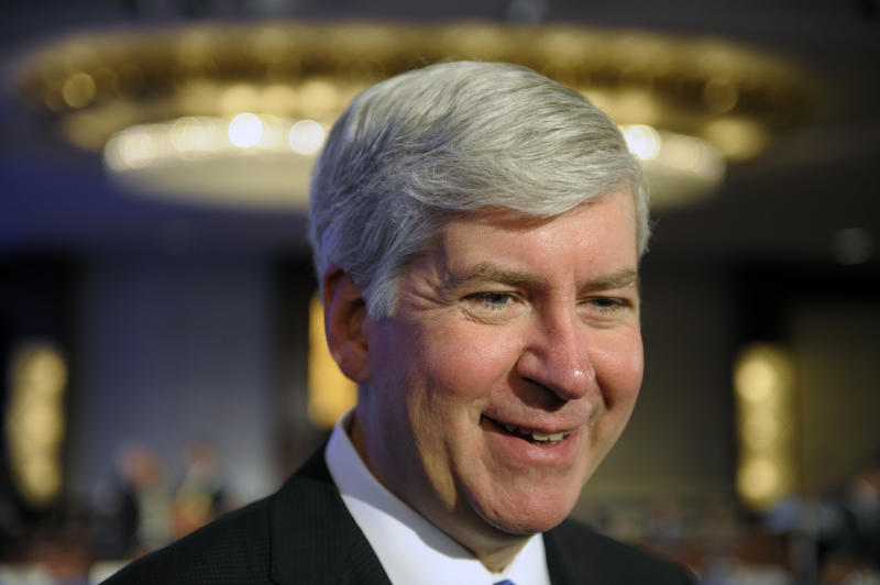 Governor Rick Snyder of Michigan participates in the opening session of the National Governors Association winter meeting in Washington, Saturday, Feb. 25, 2012. (AP Photo/Cliff Owen)