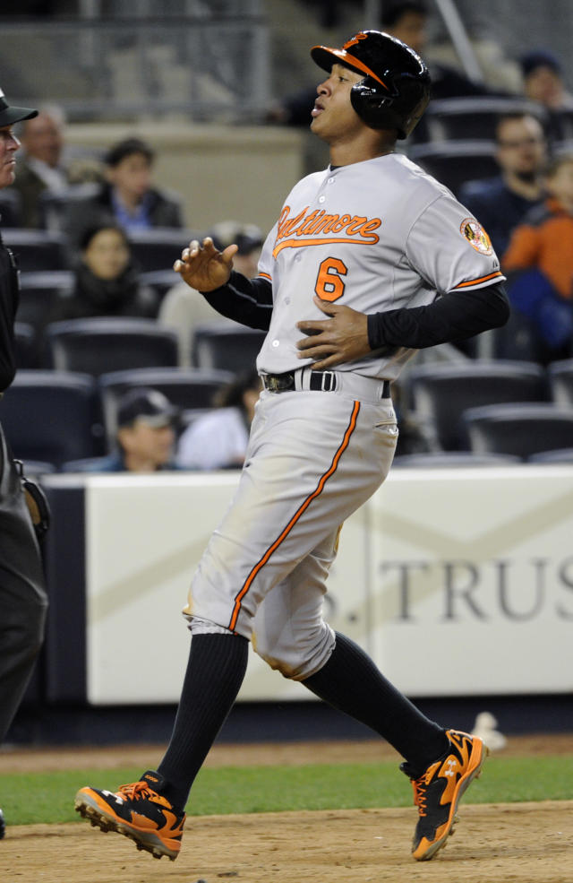 Baltimore Orioles' Jonathan Schoop scores on a sacrifice fly by Chris Davis during the ninth inning of a baseball game against the New York Yankees on Wednesday, April 9, 2014, at Yankee Stadium in New York. The Orioles won 5-4. (AP Photo/Bill Kostroun)