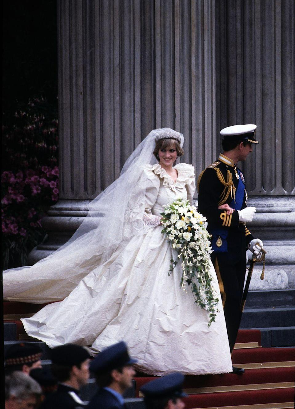 <p>Princess Diana's gown is arguably the most iconic wedding gown in history. The dramatic white dress was designed by David and Elizabeth Emanuel and featured a ruffled collar, long sleeves, and fabric for days.</p>