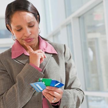 Businesswoman-holding-credit-cards_web