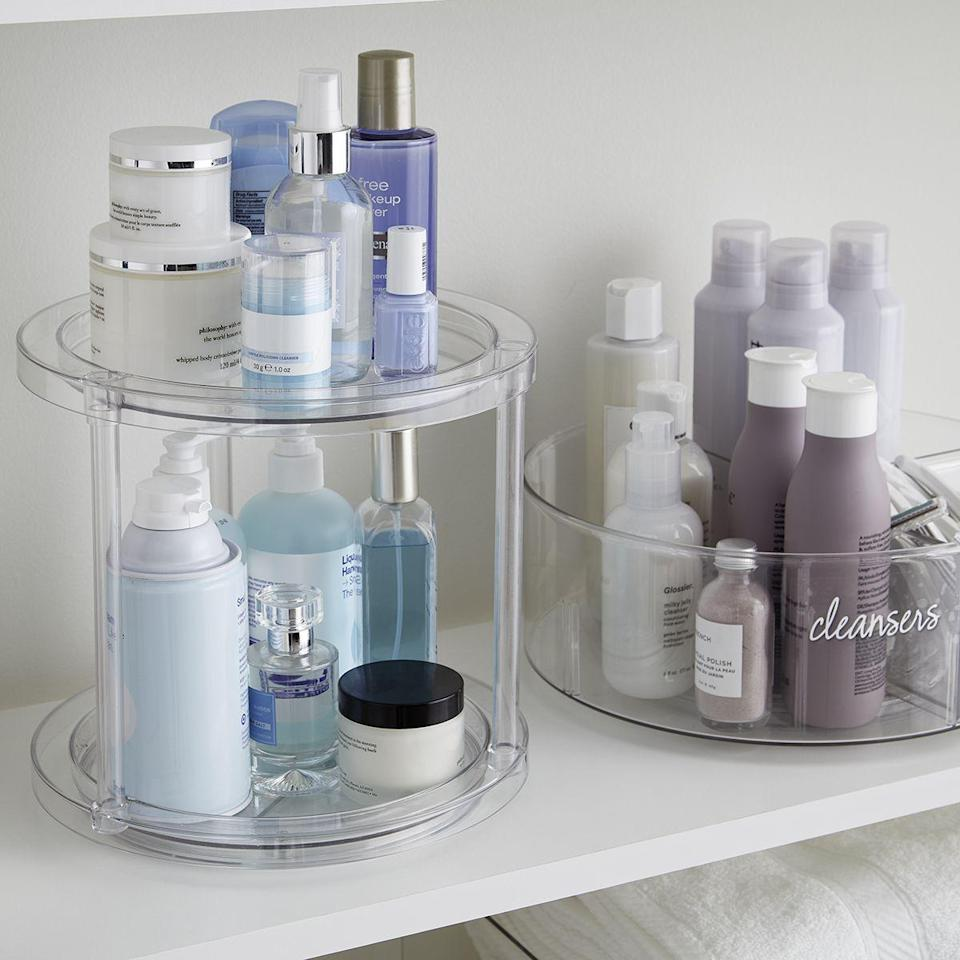 """<p><strong>THE HOME EDIT</strong></p><p>containerstore.com</p><p><strong>$25.99</strong></p><p><a href=""""https://go.redirectingat.com?id=74968X1596630&url=https%3A%2F%2Fwww.containerstore.com%2Fs%2Fkitchen%2Fthe-home-edit-collection%2Fthe-home-edit-2_tier-lazy-susan%2F12d%3FproductId%3D11010526&sref=https%3A%2F%2Fwww.countryliving.com%2Fhome-maintenance%2Forganization%2Fg34032194%2Fthe-home-edit-organizers%2F"""" rel=""""nofollow noopener"""" target=""""_blank"""" data-ylk=""""slk:Shop Now"""" class=""""link rapid-noclick-resp"""">Shop Now</a></p><p>You can use this taller, two-tier Lazy Susan for larger spices or to display skincare products in the bathroom. </p>"""