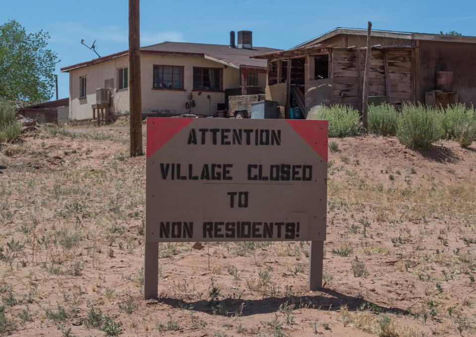 A sign warning non residents to stay out in the Navajo Nation town of Tuba City during the 57 hour curfew, imposed to try to stop the spread of the Covid-19 virus through the Navajo Nation, in Arizona on May 24, 2020. - Weeks of delays in delivering vital coronavirus aid to Native American tribes exacerbated the outbreak, the president of the hard-hit Navajo Nation said, lashing the administration of President Donald Trump for botching its response. Jonathan Nez told AFP in an interview that of the $8 billion promised to US tribes in a $2.2 trillion stimulus package passed in late March, the first tranche was released just over a week ago. (Photo by Mark RALSTON / AFP) (Photo by MARK RALSTON/AFP via Getty Images)