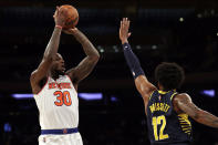 New York Knicks forward Julius Randle (30) shoots over Indiana Pacers forward Oshae Brissett (12) during the second half of a preseason NBA basketball game Tuesday, Oct. 5, 2021, in New York. The Knicks won 125-104. (AP Photo/Adam Hunger)