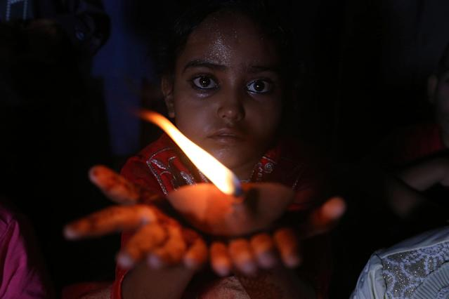 <p>A Pakistani girl attends a vigil on the World Thalassemia Day with others Karachi, Pakistan, Monday, May 8, 2017. Pakistan also observed the World Thalassemia Day, medical institutes organized numerous events to raise awareness about the disease. (AP Photo/Shakil Adil) </p>