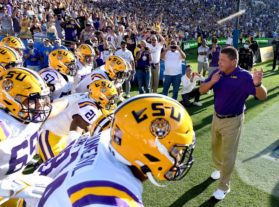 PASADENA, CA - SEPTEMBER 04: LSU head football coach Ed Orgeron leads his team on to the field against UCLA at the Rose Bowl in Pasadena on Saturday, Sept. 4, 2021. The UCLA Bruins host the LSU Tigers in a NCAA college football game at the Rose Bowl in Pasadena. (Photo by Will Lester/MediaNews Group/Inland Valley Daily Bulletin via Getty Images)