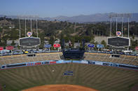 Tommy Lasorda's retired No. 2 is painted on the outfield grass at Dodger Stadium, Friday, Jan. 8, 2021, in Los Angeles. Lasorda, the fiery Hall of Fame manager who guided the Los Angeles Dodgers to two World Series titles and later became an ambassador for the sport he loved during his 71 years with the franchise, has died. He was 93. (AP Photo/Marcio Jose Sanchez)