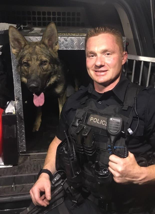 The VPD Canine Unit tweeted a photo of officer Jonathan Kempton, a trainer with the unit, in July 2018. (VPD Canine Unit - image credit)