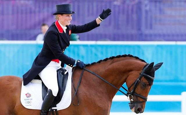 FILE PHOTO: Zara Phillips of Britain riding High Kingdom waves after performing during the equestrian Eventing Individual Dressage Day 2 in the Greenwich Park during the London 2012 Olympic Games