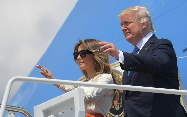 Donald Trump and his wife Melania wave before boarding Air Force One for his first trip abroad as US president