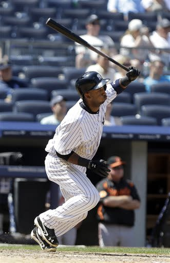 New York Yankees' Eduardo Nunez follows through on an RBI single during the sixth inning of a baseball game against the Baltimore Orioles on Saturday, July 6, 2013, in New York. (AP Photo/Frank Franklin II)