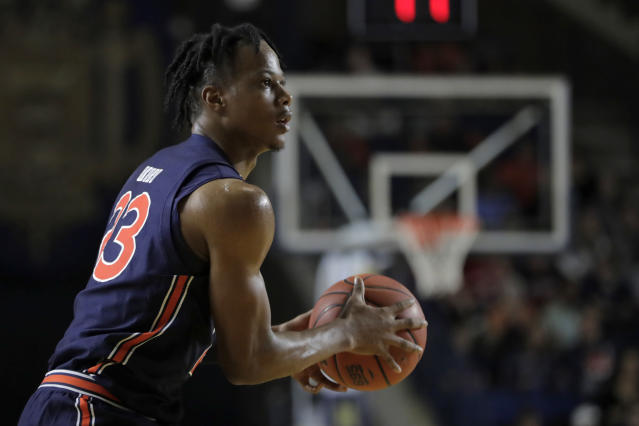 Auburn forward Isaac Okoro looks to shoot against Davidson during the first half of an NCAA college basketball game at the Veterans Classic Tournament, Friday, Nov. 8, 2019, in Annapolis, Md. (AP Photo/Julio Cortez)