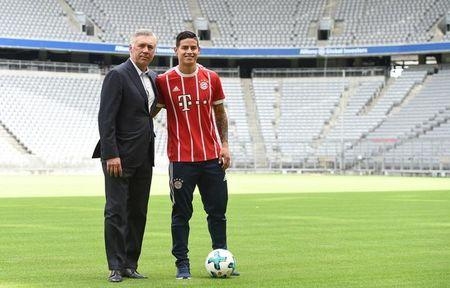 Colombian midfielder James Rodriguez presents his new match jersey with Bayern Munich coach Carlo Ancelotti in Munich, Germany July 12, 2017. REUTERS/Andreas Gebert