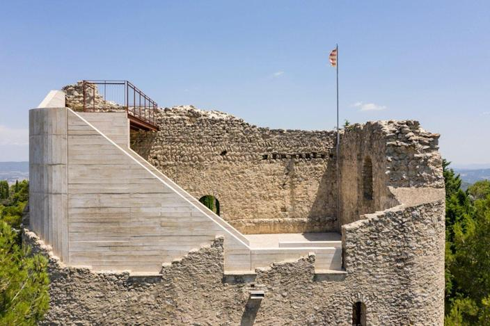Modern staircases from architect Meitxell Inaraja turn Italy's historic Castell de la Tossa into an incredible lookout point.