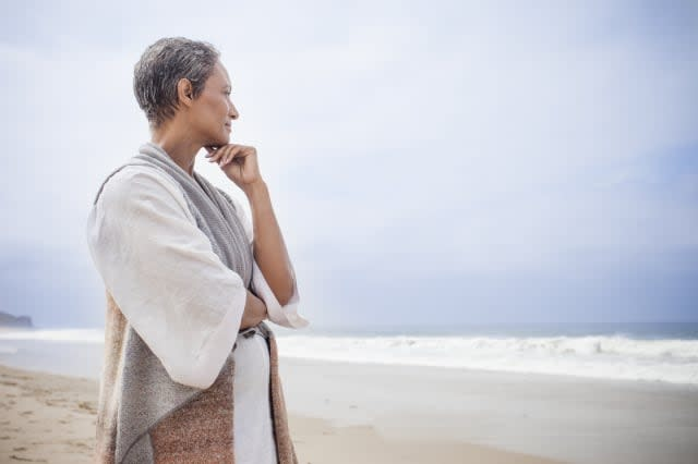 Senior African American Woman Relaxing on Beach