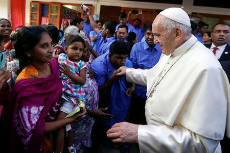 Pope Francis meets with sick people and staff of the Mother Teresa House in the Dhaka's Tejgaon neighborhood, Bangladesh, December 2, 2017. REUTERS/Andrew Medichini/Pool