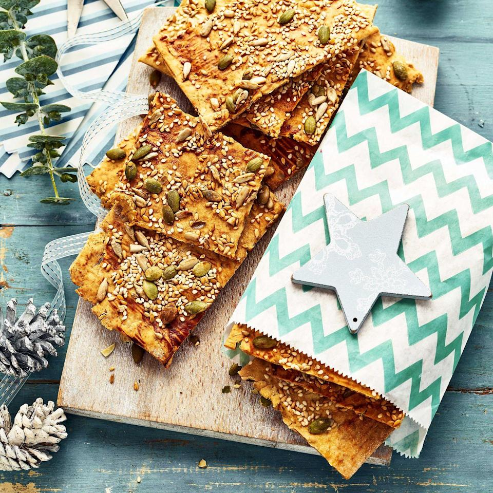 """<p>These make a wonderful accompaniment to cheese and pickles, or simply enjoyed as a snack by themselves.</p><p><strong>Recipe: <a href=""""https://www.goodhousekeeping.com/uk/christmas/christmas-recipes/a37820257/gluten-free-seeded-crackers/"""" rel=""""nofollow noopener"""" target=""""_blank"""" data-ylk=""""slk:Gluten-Free Seeded Crackers"""" class=""""link rapid-noclick-resp"""">Gluten-Free Seeded Crackers</a></strong></p>"""