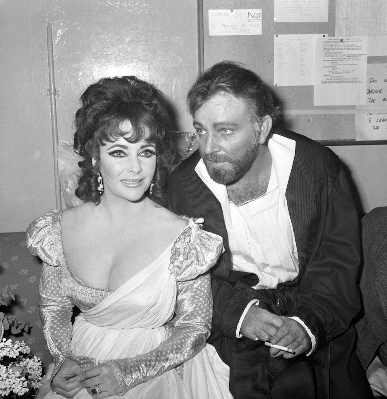 Elizabeth Taylor and Richard Burton after appearing in the first night of the Oxford University Dramatic Society production of Marlowe's Dr Faustus at the Playhouse Theatre. Mr Burton played the title role and wife played the non-speaking part of Helen of Troy. When the play ended last night, the cast took 15 curtain calls and enjoyed over nine minutes of applause.