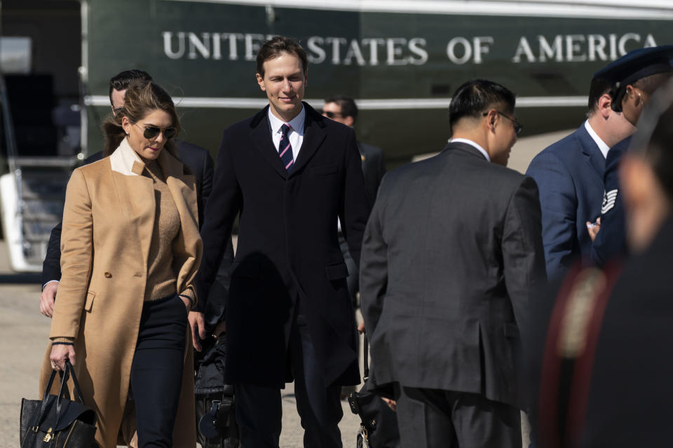 Counselor to the President Hope Hicks, left, with White House senior adviser Jared Kushner, walk from Marine One to accompany President Donald Trump aboard Air Force One as he departs Wednesday, Sept. 30, 2020, at Andrews Air Force Base, Md. (AP Photo/Alex Brandon)