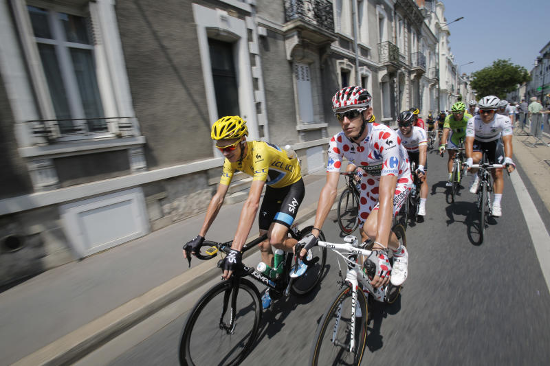 Christopher Froome of Britain, wearing the overall leader's yellow jersey, Pierre Rolland of France, wearing the best climber's dotted jersey, Michal Kwiatkowski of Poland, wearing the best young rider's white jersey, and Britain's Marc Cavendish , rear left in white, ride during the thirteenth stage of the Tour de France cycling race over 173 kilometers (108.1 miles) with start in in Tours and finish in Saint-Amand-Montrond, western France, Friday July 12 2013. (AP Photo/Christophe Ena)