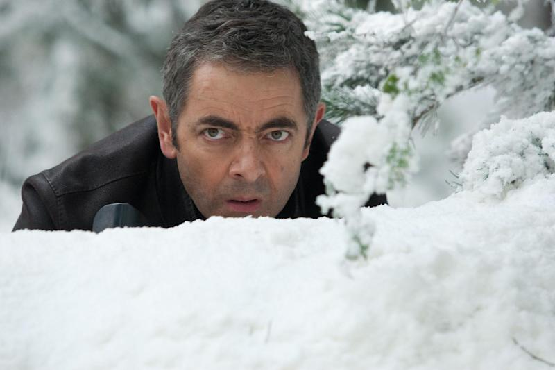 """In this film image released by Universal Pictures, Rowan Atkinson is shown in a scene from """"Johnny English Reborn"""". (AP Photo/Universal Pictures, Giles Keyte)"""