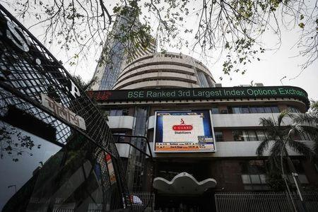 Bombay Stock Exchange building is pictured next to a police van in Mumbai