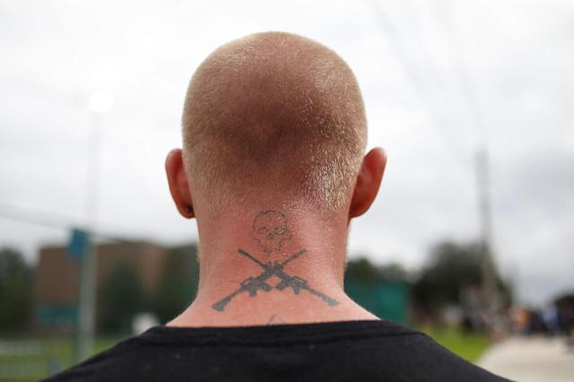 <p>Tyler Tenbrink, a self proclaimed White Nationalist who drove from Texas, stands before the speech by Richard Spencer, an avowed white nationalist and spokesperson for the so-called alt-right movement, on the campus of the University of Florida in Gainesville, Fla., Oct. 19, 2017. (Photo: Shannon Stapleton/Reuters) </p>