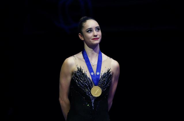 Figure Skating - World Figure Skating Championships - The Mediolanum Forum, Milan, Italy - March 23, 2018 Canada's Kaetlyn Osmond poses with her medal after winning gold in the Ladies Free Skating REUTERS/Alessandro Bianchi