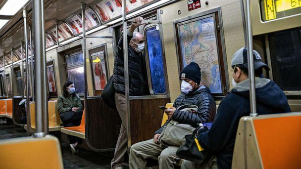 PHOTO: Passengers wearing face masks ride the subway, on April 28, 2020, in New York City. (Jeenah Moon/Getty Images)