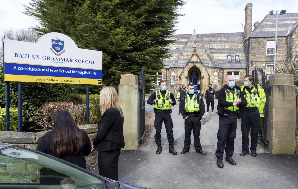 Police have been at Batley Grammar School since the protests started. (SWNS)