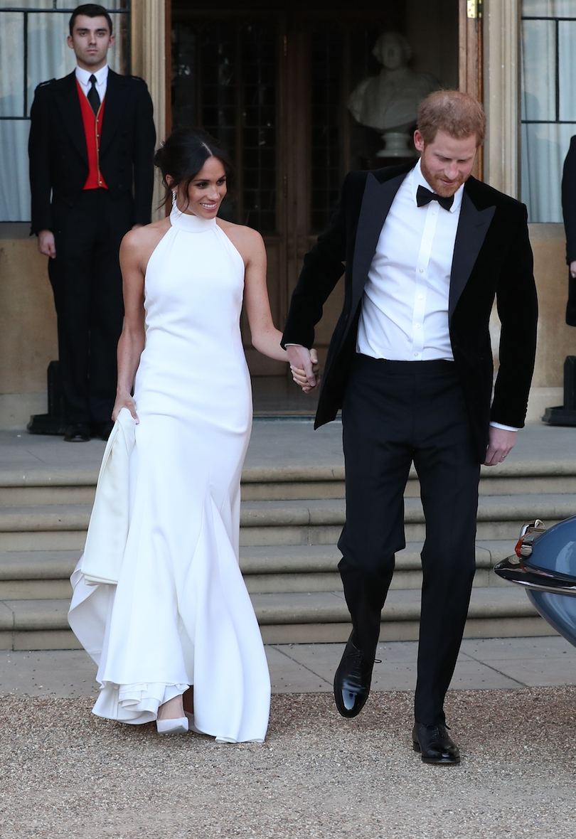 <p>But her tell-all wedding looks did not stop at the dress. For her eveing reception, Meghan stepped out in a halterneck, floor-length white gown by British designer Stella McCartney.<br><br>The choice to wear the famously sustainable fashion brand said everything about Meghan's sentiments. <br>[Photo: Getty] </p>