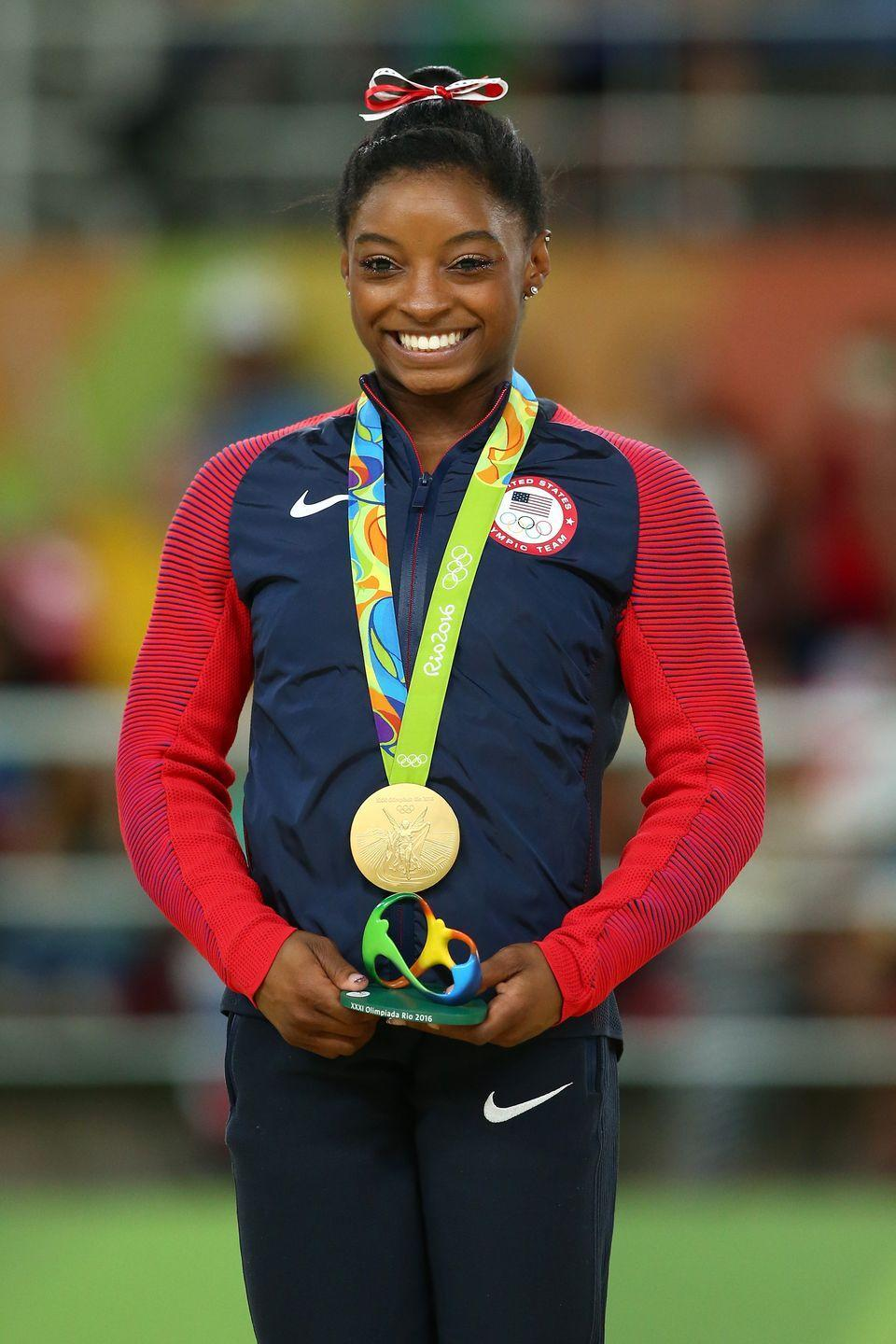 <p>Simone Biles had already racked up an impressive title count in World competitions from 2013 until 2015, but the then-19-year-old gymnast didn't compete on the Olympic stage until the 2016 Summer Games held in Rio de Janeir0. Not only did fans fall in love with Biles during her Olympic debut, she took home four gold and one bronze medal.</p>