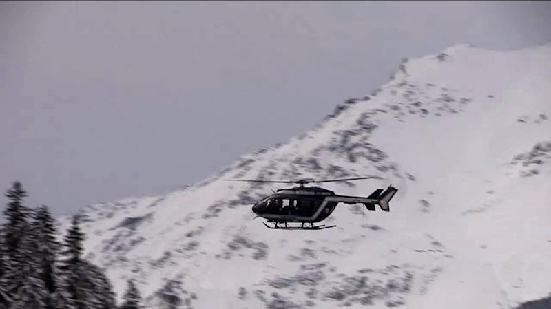 A helicopter hovers over the site of an avalanche that killed five French Foreign Legionnaires (AFP Photo/)