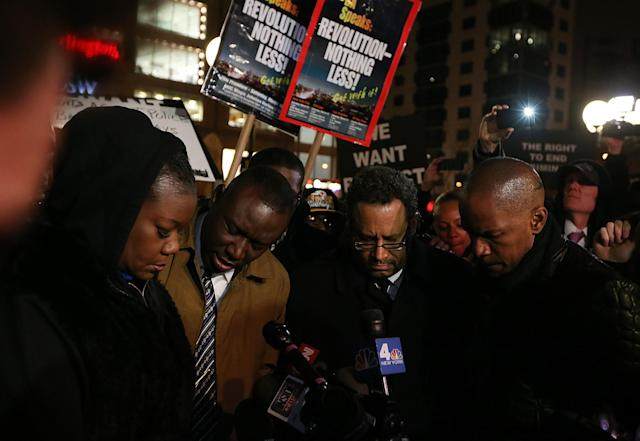 NEW YORK, NY - FEBRUARY 26: (L to R) Sybrina Fulton, Trayvon Martin's mother Sybrina Fulton, attorney Benjamin Crump, author Michael Eric Dyson and actor Jamie Foxx attend a candlelight vigil for Martin in Union Square on February 26, 2013 in New York, New York. Some participants wore hoodies to honor Martin. Vigils were held in Florida and New York on the one year anniversary of teenager Trayvon Martin's shooting death by George Zimmerman in Florida. (Photo by Mario Tama/Getty Images)