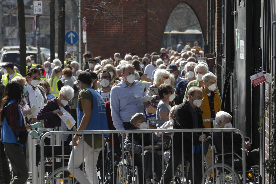 File- In this Wednesday, March 31, 2021 file photo, people line up in front of the vaccination center at the Arena Treptow in Berlin, Germany. Germany's health minister Jens Spahn says today the country has now given a first coronavirus vaccine shot to more than half of its population. (AP Photo/Markus Schreiber, file)