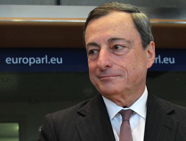 President of the European Central Bank Mario Draghi addresses the Economic and Monetary Affairs Committee, at the European Parliament, Monday, Sept. 23, 2013. Economic affairs MEP's and Mario Draghi will debate monetary affairs, economic governance and banking union. (AP Photo/Yves Logghe)