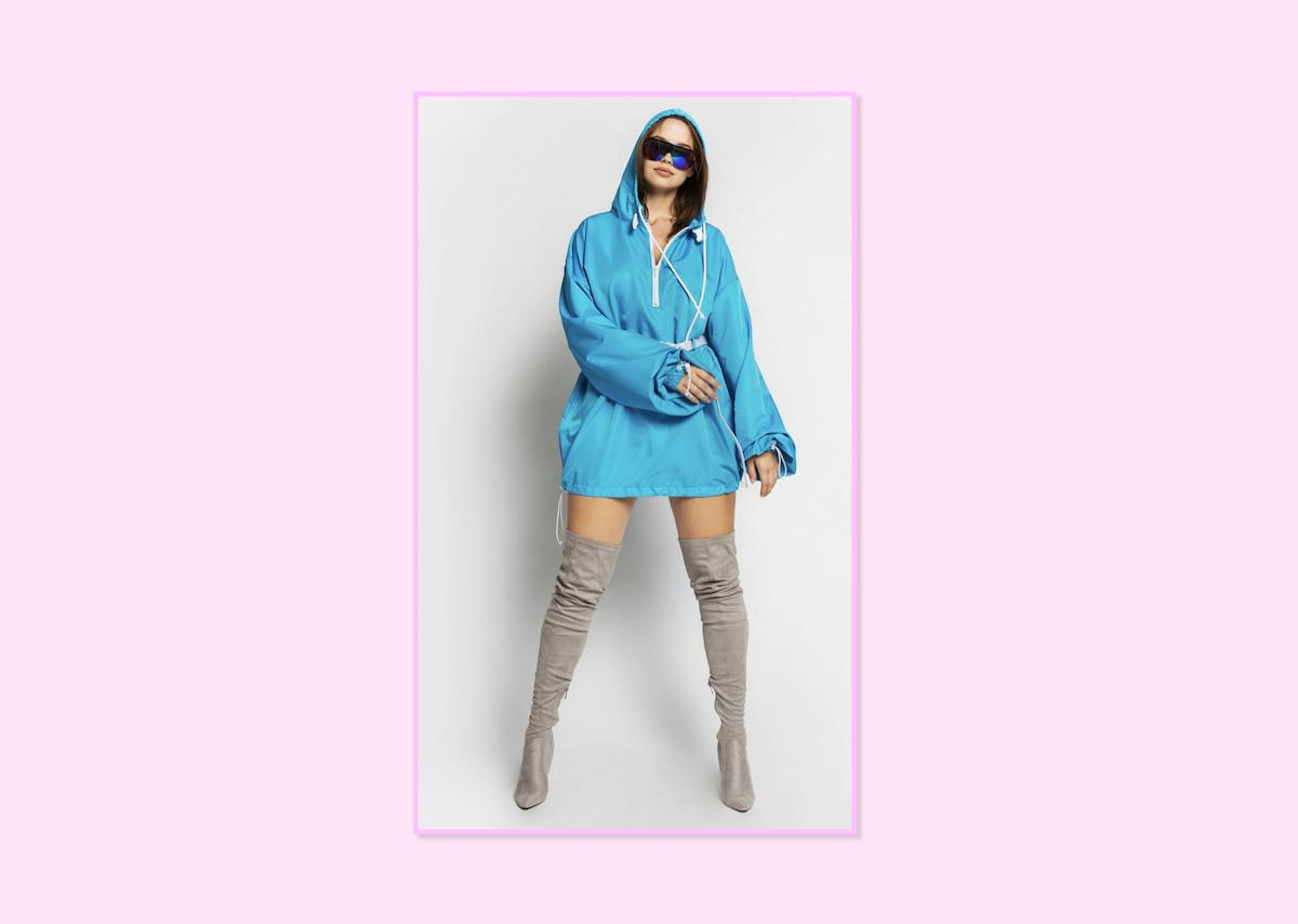 "<p><a rel=""nofollow"" href=""https://bynadiaaboulhosn.com/collections/shop-the-line/products/hooded-coach-jacket-blue"">Hooded Coach Jacket in Blue</a>, $100, By Nadia Aboulhosn (Photo: By Nadia Aboulhosn) </p>"