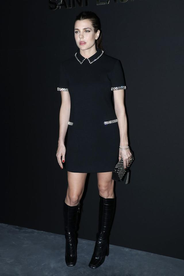 <p>Charlotte sat front row at the Saint Laurent fashion show during Paris Fashion Week. She chose a collared dress with pocket detailing and knee high black boots. </p>
