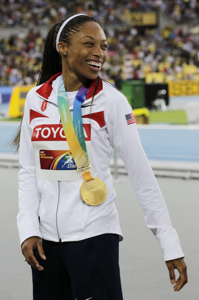 Allyson Felix reacts with her gold medal for the Women's 4x400m Relay at the World Athletics Championships in Daegu, South Korea, Sunday, Sept. 4, 2011. (AP Photo/Anja Niedringhaus)